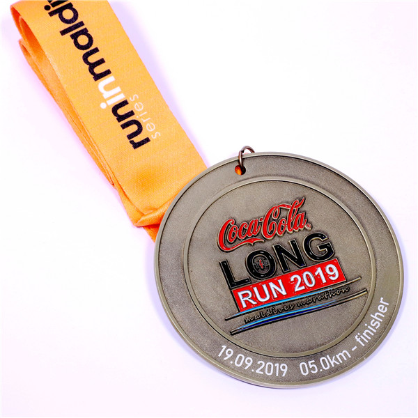 coca cola running game medal